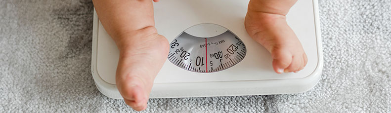 weighing a baby on a scale
